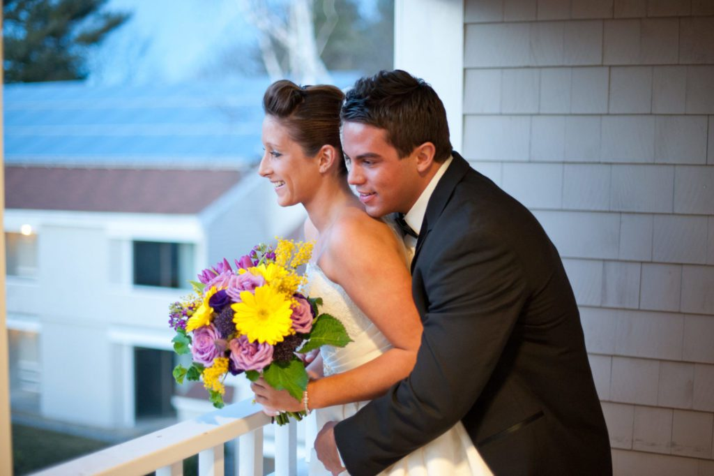 Wedding Couple looking out over balcony at Meadowmere Hotel Resort Ogunquit Maine